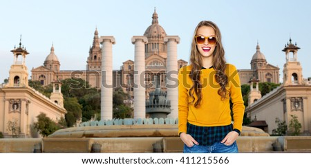 people, travel, tourism and fashion concept - happy young woman or teen girl in casual clothes and sunglasses over national museum of barcelona background - stock photo