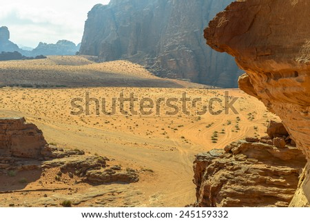 People travelling in Wadi Rum desert, Jordan - stock photo