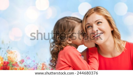 people, trust, love, family and motherhood concept - happy daughter whispering gossip to her mother over blue lights and poppy field background - stock photo