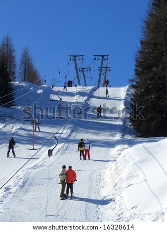 People using a double skilift in Nassfeld, Austria - stock photo