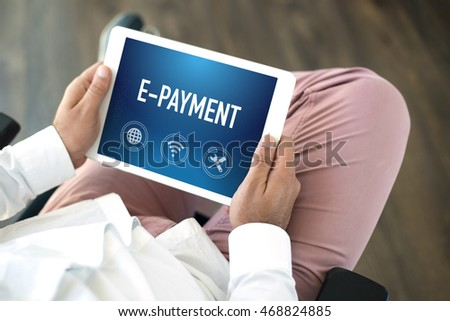 People using tablet pc and E-PAYMENT concept on screen