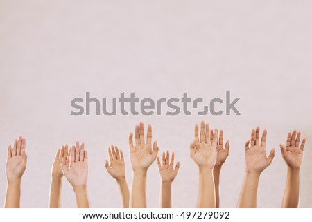 People voting with their hands, isolated on beige