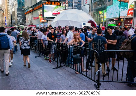 People waiting in line for OnePlus 2 smart phone event on Times Square in New York City - July 31, 2015, Times Square, New York City, NY, USA - stock photo