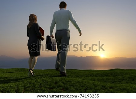 People walk on the green grass. - stock photo