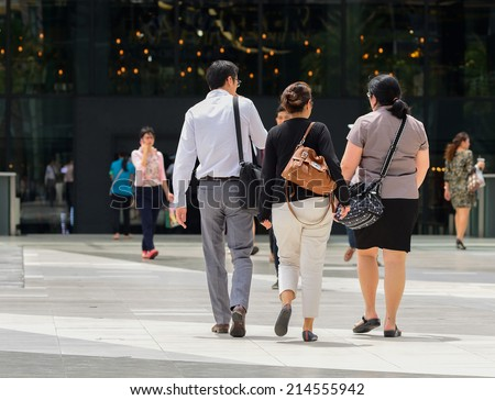 People walking against  background of an urban landscape. - stock photo