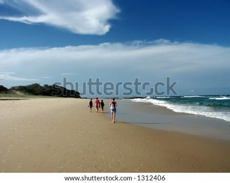 people walking along beach stradboke island australia - stock photo