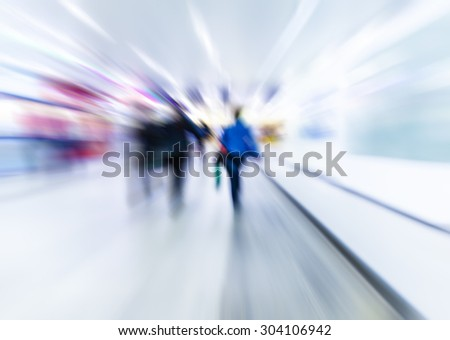 people walking in metro station on rush hour,blurred background