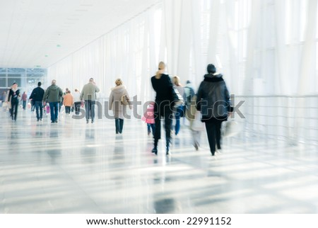 People walking in modern downtown. Blurred motion.