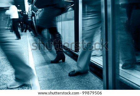 People walking in subway with motion blurred. - stock photo