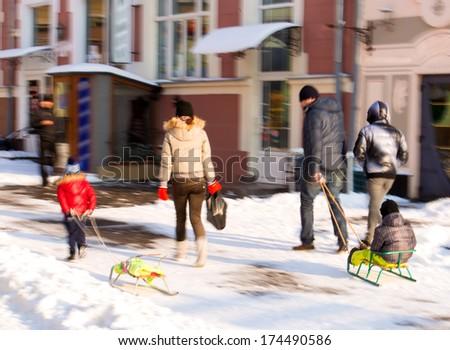 People walking in the street in motion blur - stock photo