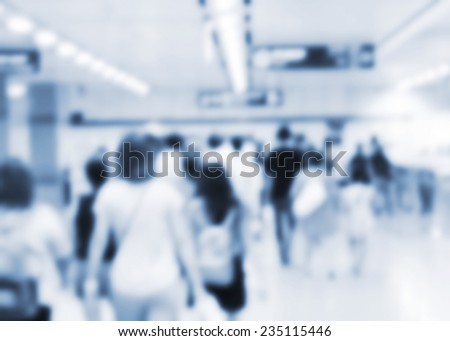People walking in the subway station. Blur background.