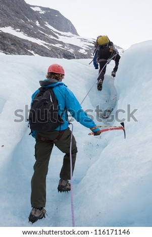 People walking on Bodalsbreen glacier (Jostedalsbreen national park, Norway) - stock photo