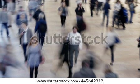 people walking on crowded public street. anonymous pedestrians commuting in the city. society population growth background   - stock photo