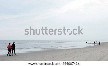 People walking on the beach by Bergen aan Zee Netherlands June 2016