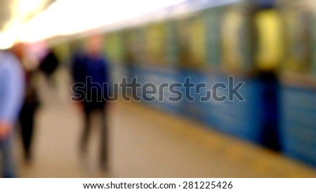 People walking on train station, blurred background - stock photo