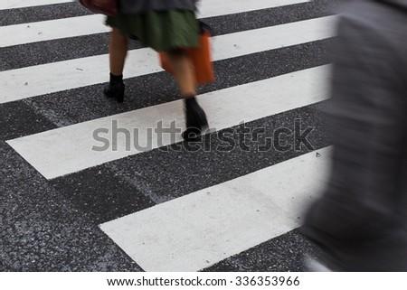 people walking on zebra crosswalk  - stock photo