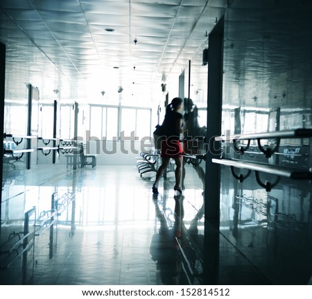People walking through the hospital corridor. blurred motion - stock photo