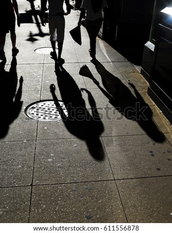 stock-photo-people-walking-with-harsh-sh