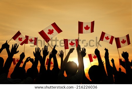 People Waving The Fags of Switzerland - stock photo