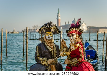 People Wearing Costumes and Masks at the Carnival of Venice - stock photo