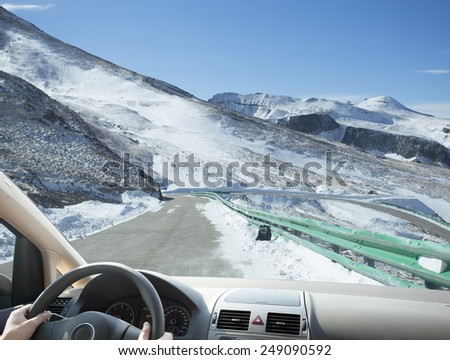 People winter driving in mountain area