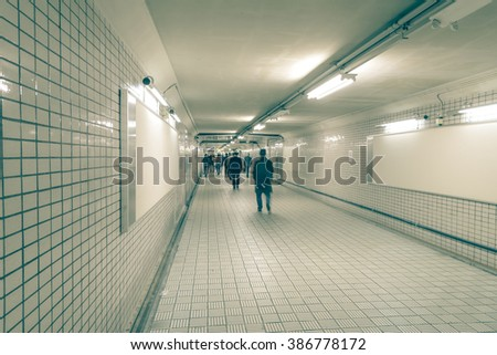 People with Billboard in subway - stock photo