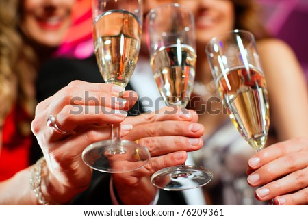 People with champagne in a bar or casino having lots of fun - stock photo