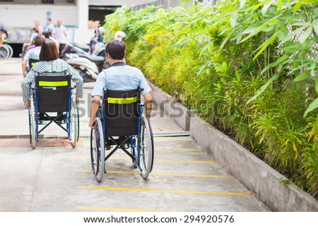 People with disabilities can access anywhere in public place with wheelchair,that make them independent in transportation and feel they are not the stranger from social. - stock photo