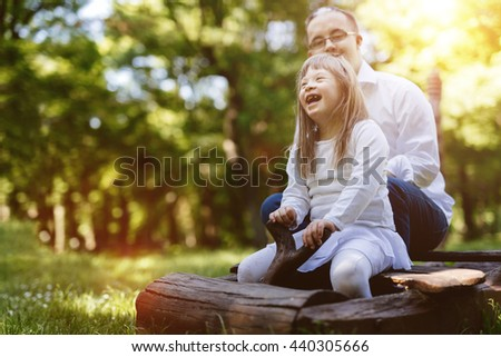 People with down syndrome having fun outdoors and smiling - stock photo
