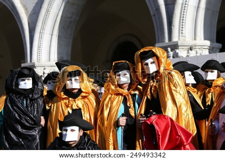 People with Golden costumes for the Carnival in Venice Italy - stock photo