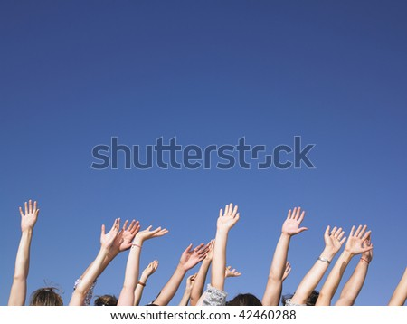 People with hands in the air. Horizontal. - stock photo