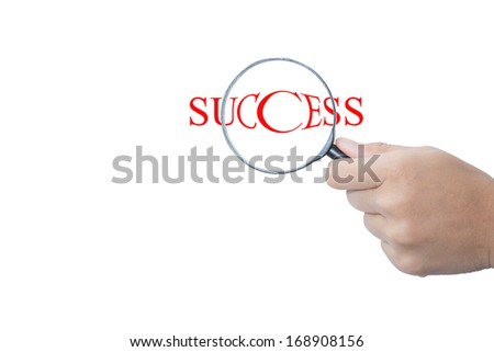 People with Magnifying Glass and Word Success on White Background  - stock photo
