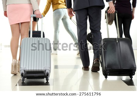 People with suitcases in airport - stock photo