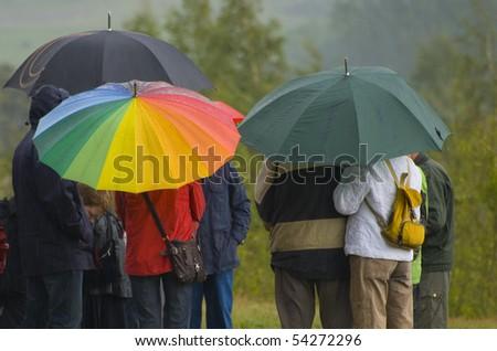 people with umbrellas - stock photo