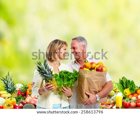 People with Vegetables over green background. Healthy diet. - stock photo