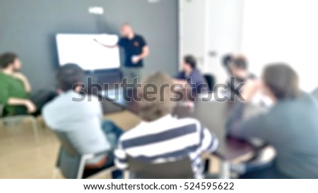 people working at office. blurred background