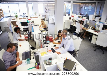 People working in a busy office - stock photo