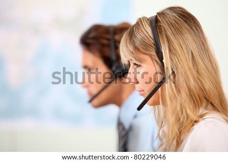 People working in call center - stock photo