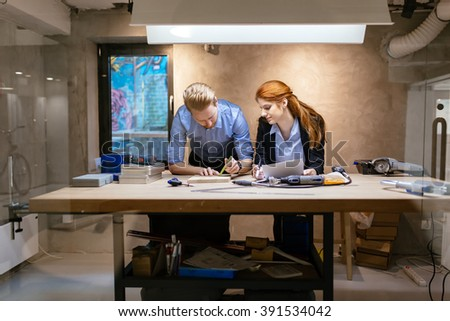 People working in modern beautiful workshop with professional equipment at hand