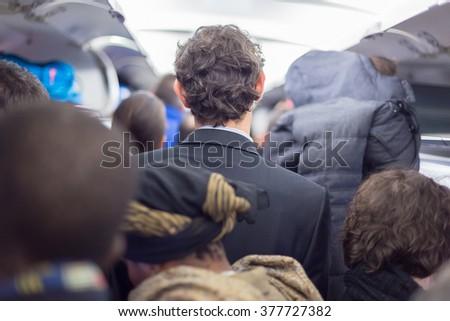 Peoplle disebarking the airplane. - stock photo