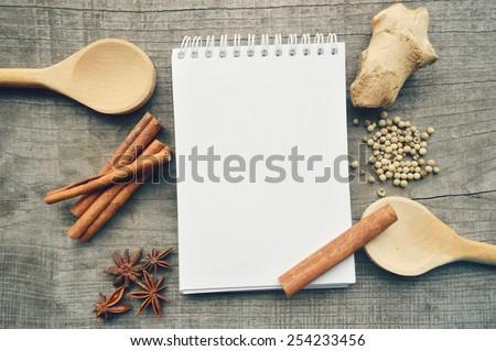 pepper,cardamom,star anise,cinnamon,coriander,cinnamon sticks,cloves,star anise,ginger,ground ginger ,Bay leaves  - stock photo