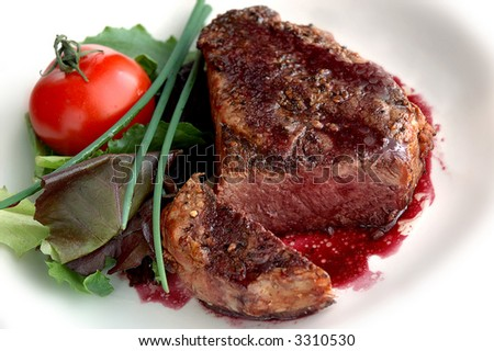 pepper-crusted filet mignon with red wine sauce - stock photo