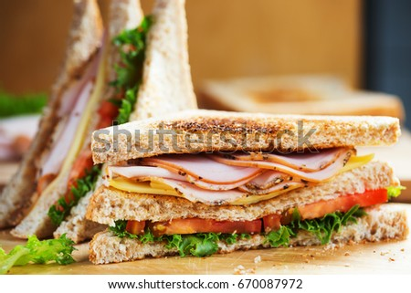 pepper ham cheese sandwich with whole wheat bread for breakfast on wooden board