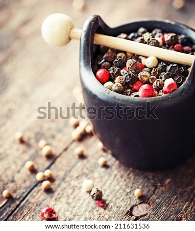 pepper in wooden background/ mixture of peppers hot pepper, red pepper, black pepper, white pepper, green pepper, background - stock photo