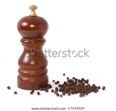 Pepper mill and black peppercorn - stock photo