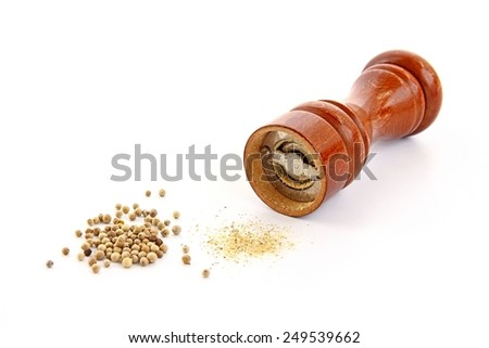 Pepper mill, white pepper and pepper powder on white background.