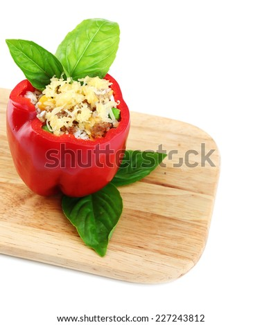 Pepper prepared for cooking stuffed paprika with meat and rice, on wooden cutting board, isolated on white - stock photo
