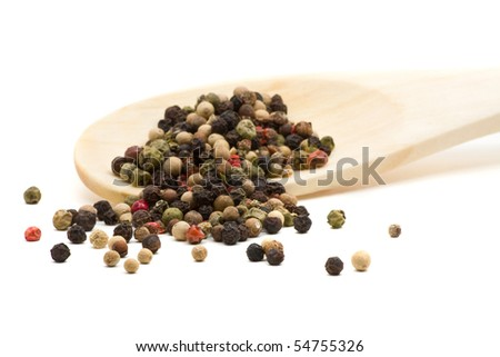 Peppercorns on wooden spoon over white background - stock photo
