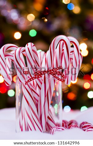 Peppermint candy canes on white background. - stock photo