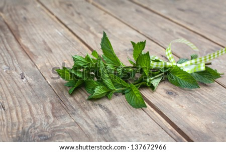peppermint plants in bunch on wooden table in summer